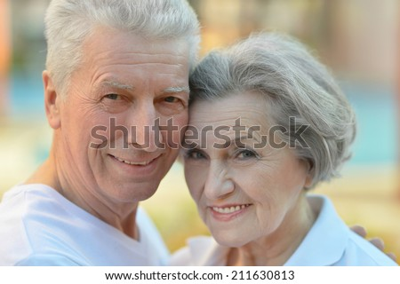 Portrait of nice smiling senior couple outdoor