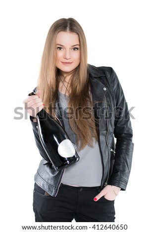 Portrait of nice woman posing in black jacket with a bottle. Isolated on white - stock photo