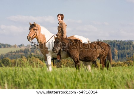 Portrait of nice woman with two horses
