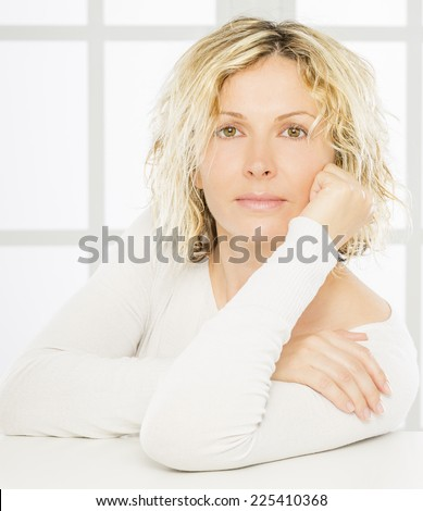Portrait of nice 40 year old woman - stock photo