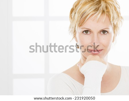 Portrait of nice, 40 years old woman - stock photo