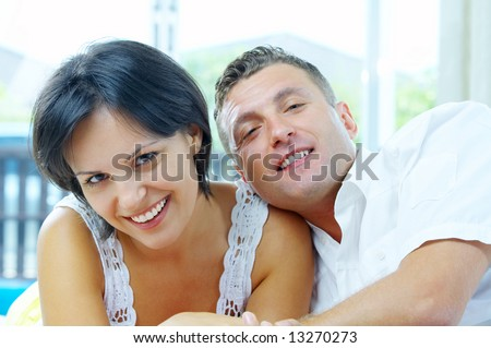 Portrait of nice young  gorgeous  couple chilling out together. Focused on girl's face.