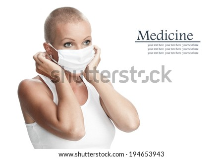 Portrait of nice young woman in surgery mask on white back