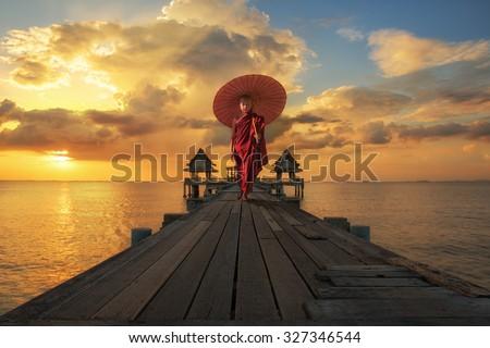 Portrait of novice walk on the wooded bridge - stock photo