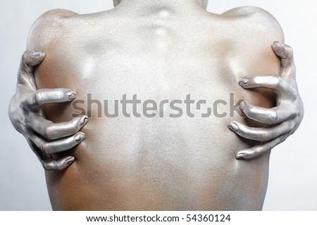 portrait of nude girl's back painted with silver - stock photo