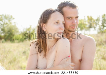 portrait of nude men and women dreaming in the sunlight