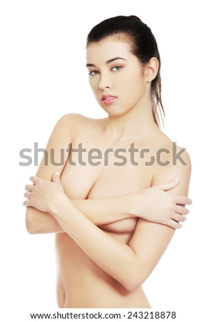 Portrait of nude woman covering her breast.