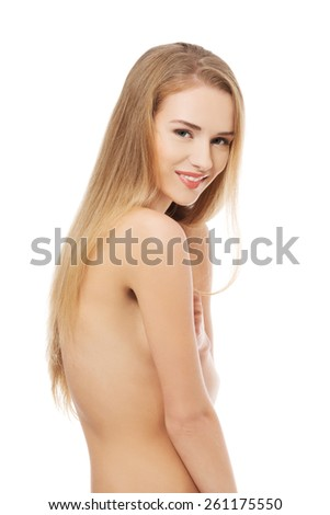 Portrait of nude woman looking at the camera.
