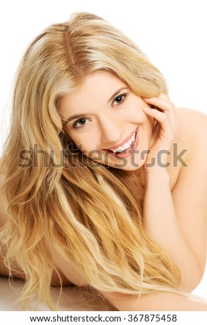 Portrait of nude woman looking at the camera - stock photo