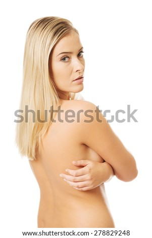 Portrait of nude woman looking through her shoulder.