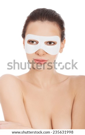 Portrait of nude woman with white facial mask. - stock photo
