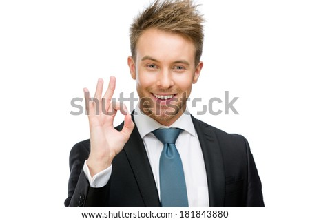 Portrait of okay gesturing businessman, isolated on white. Concept of leadership and success