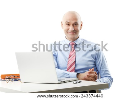Portrait of old businessman sitting in front of laptop. Isolated on white background.  - stock photo