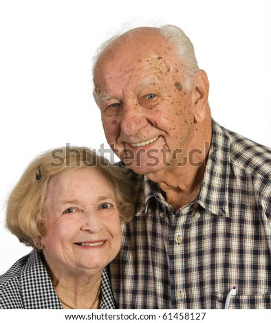 Portrait of old husband and wife couple. Shot against a white background. - stock photo