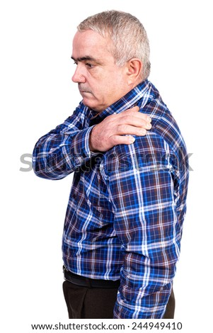 Portrait of old man suffering from  shoulder pain isolated over white background - stock photo