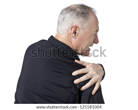 Portrait of old man suffering in shoulder pain - stock photo