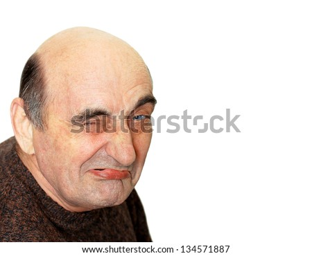 portrait of old man with a grimace on his face