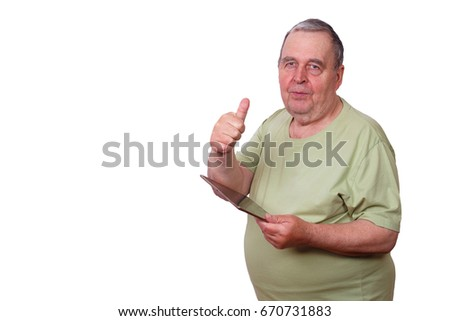 Portrait of old overweight man with tablet in hand and thumb up gesture