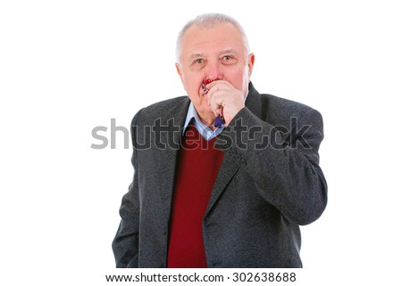 Portrait of old senior business man dressed in suit, shirt and marsala cardigan, blowing his nose into a tissue with a cold, flu or allergy, isolated on white background. facial expressions - stock photo