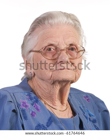 Portrait of old senior woman with glasses. Shot against white background. - stock photo