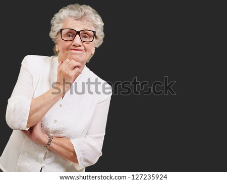 Portrait Of Old Woman On Black Background - stock photo