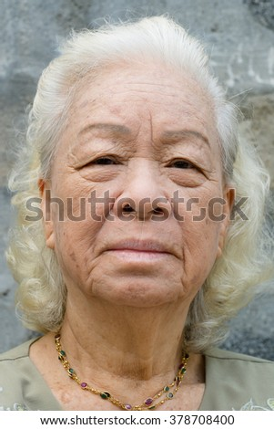 Portrait of old woman , The gray-haired elderly woman
