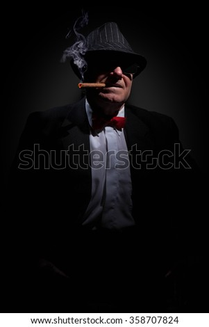 Portrait of omerta boss with cigar and glasses. - stock photo