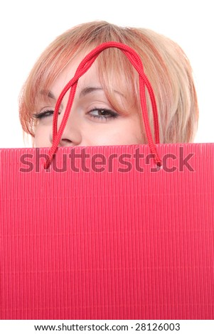 portrait of one happy young adult girl with colored bag - stock photo