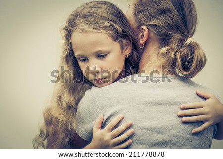 portrait of one sad daughter hugging his mom - stock photo