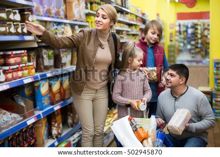 Portrait of ordinary european family with two children in local supermarket