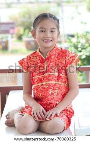 Portrait of oriental girl in Chinese style dress, Thailand. - stock photo