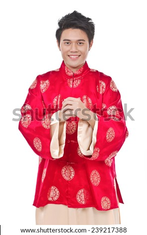Portrait of Oriental young man with tradition clothing - stock photo