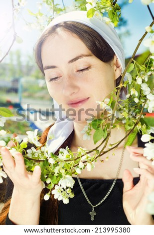 Portrait of orthodox young woman in kerchief - stock photo