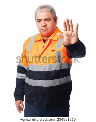 portrait of outdoor worker doing a stop symbol