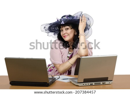 Portrait of owner on-line dating agency.  Mature woman in hat sitting in the office on white background