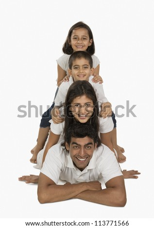 Portrait of parents with their children smiling