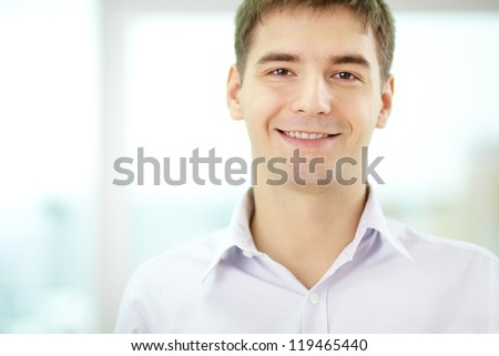 Portrait of pensive businessman looking at camera