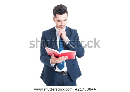 Portrait of pensive businessman or lawyer reading a book or studying a new law isolated on white background - stock photo