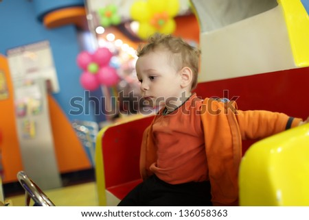Portrait of pensive child at indoor playground