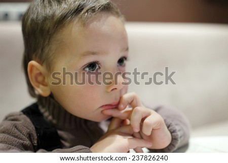 Portrait of pensive child in a cafe - stock photo