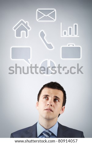 Portrait of pensive man thinking of what to choose - stock photo