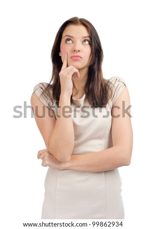 Portrait of pensive young woman looking up, over white background - stock photo