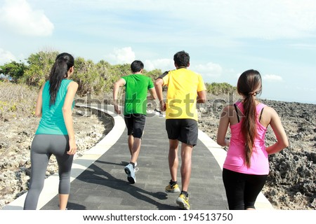 portrait of people running together. sport exercise - stock photo