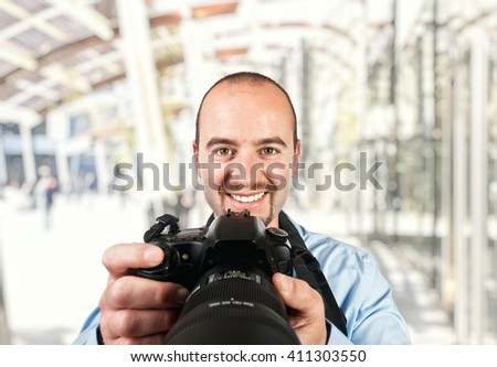 portrait of photographer and modern building background - stock photo