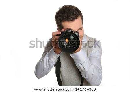 Portrait of photographer holding digital camera - stock photo