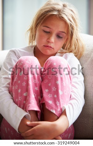 Portrait Of Physically Abused Child At Home - stock photo