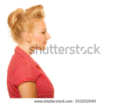 Portrait of pin-up blond girl with hair bun isolated on white. Young woman in retro style. Copy space. Studio shot.