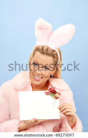 portrait of pink bunny girl with empty greeting card