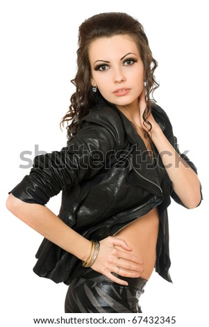 Portrait of playful brunette in black clothes. Isolated