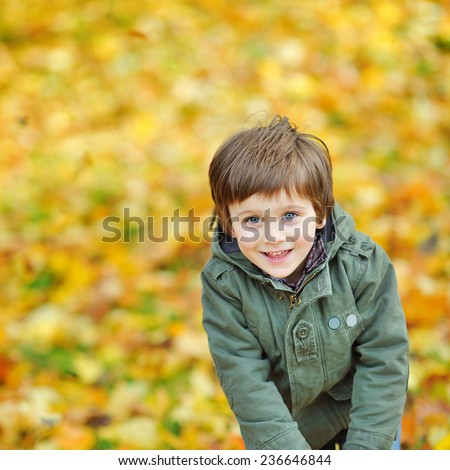 Portrait of playful little boy in the park - stock photo